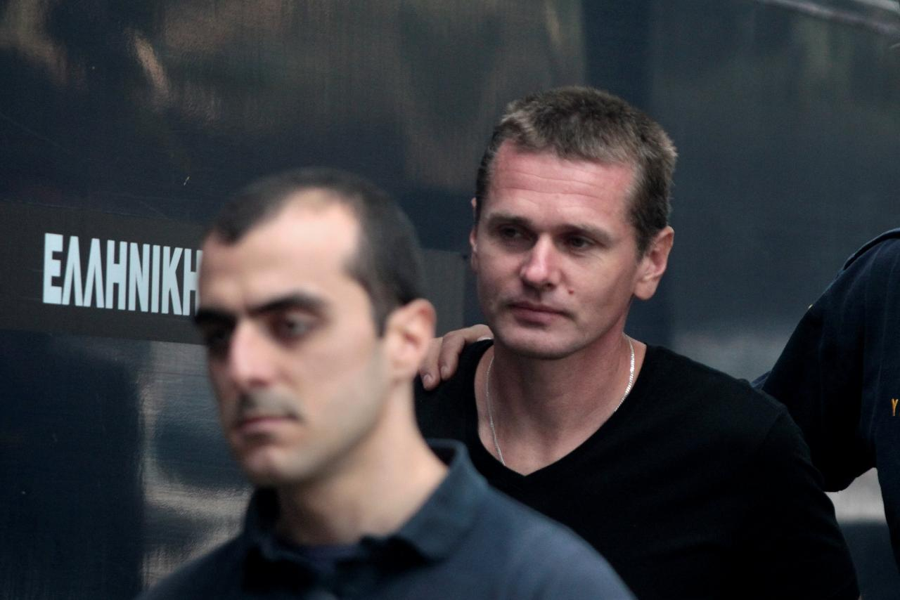 Alexander Vinnik, a 38 year old Russian man suspected of running a money laundering operation using bitcoin, is escorted by police officers to a court in Thessalonik