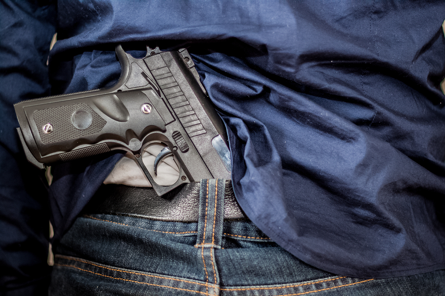The man hid the gun behind their backs robbery crime kidnapping