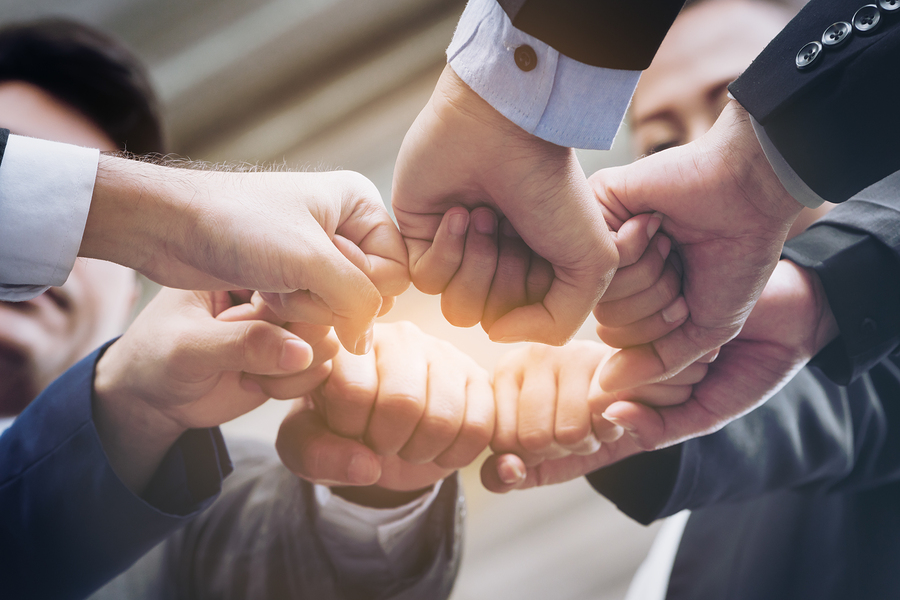 Joining Hands Showing Teamwork